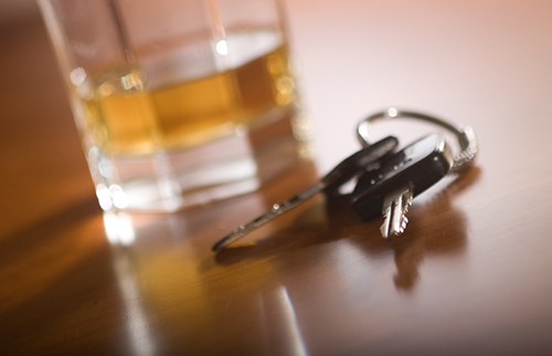 car keys with a glass of alcohol