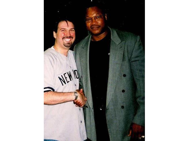 Adam M. Thompson & Larry Holmes
