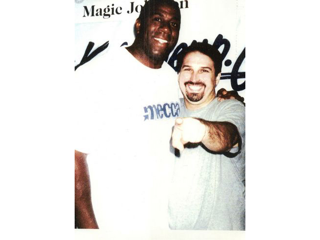 Adam M. Thompson & Magic Johnson