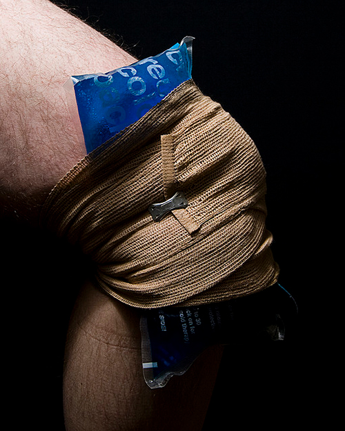 Knee with ice pack wrapped on it